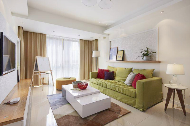 绿色的沙发带来一抹清新之感。