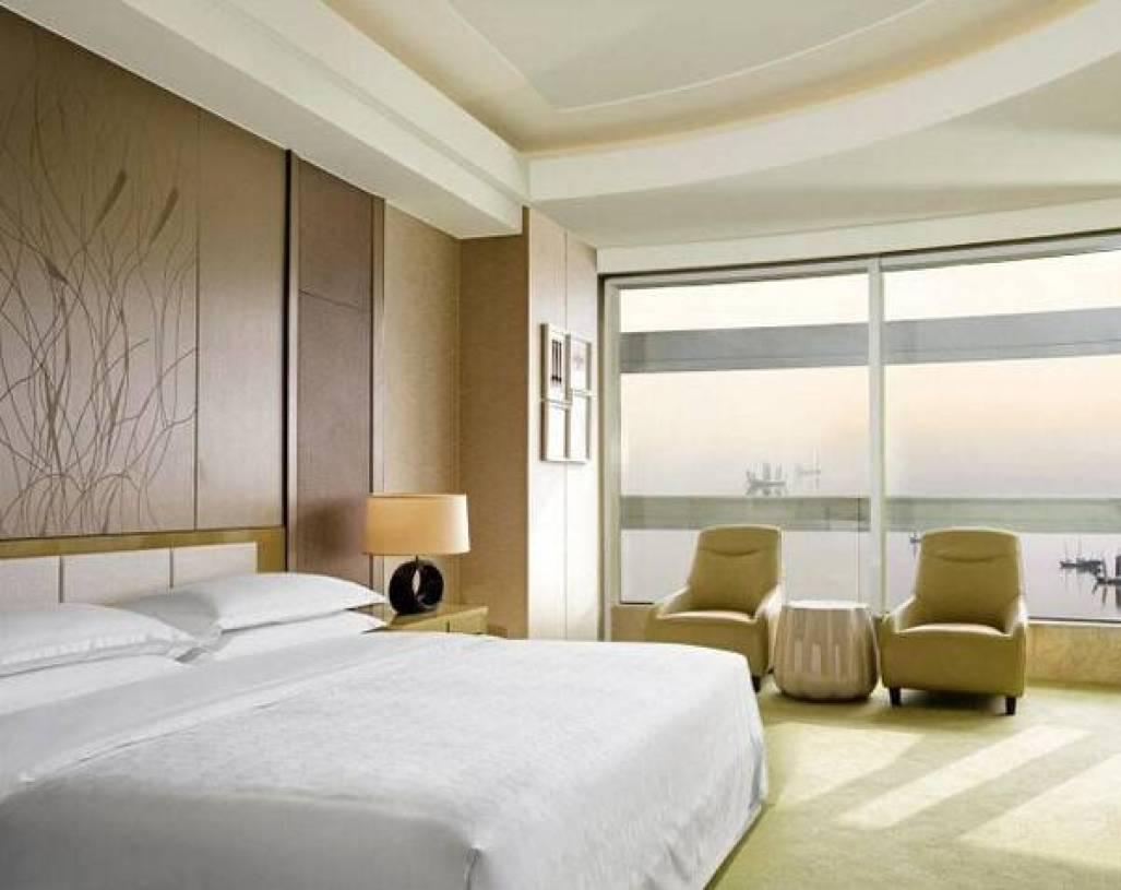 简约风格快捷酒店卧室床头背景墙装修效果图-简约风格