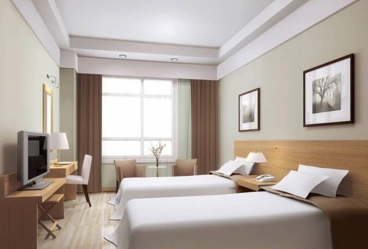 简约风格宾馆房间背景墙装修效果图-简约风格床图片