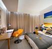 黄色现代卧室背景墙设计