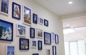 2016现代风格米色照片墙装饰案例