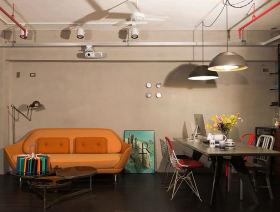 橙色现代工业风客厅沙发装饰图