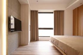 橙色简约卧室背景墙设计装潢